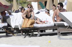 http://img212.imagevenue.com/loc1063/th_312350256_Mischa_Barton_Bikini_Candids_on_the_Beach_in_Miami_December_27_2011_174_122_1063lo.jpg