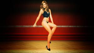 Daniela Ruah Leggy on a pole wallpaper