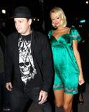 Paris Hilton leggy in green dress leaving Beso in Hollywood