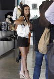 Audrina Patridge shows legs and cleavage in white tank top while shopping at DDCLAB in West Hollywood